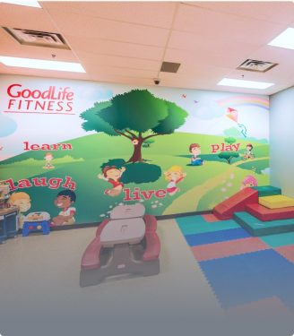 Childminding area in a GoodLife Fitness Club with a mural on the wall and equipment for kids