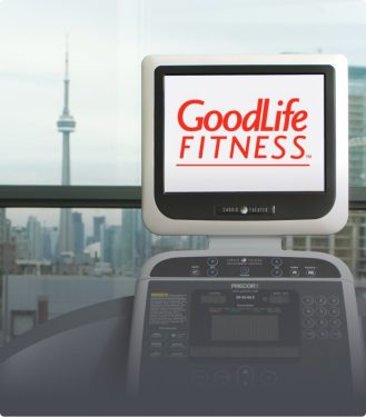Cardio machine with the GoodLife Fitness logo on the screen and the CN tower in the background