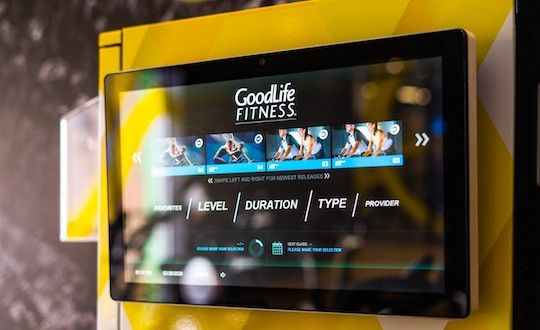 Touchscreen with different types of GoodLife workouts.